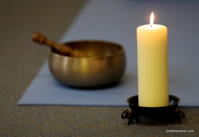 Candle and singing bowl Yoga Glow Studio Beccles